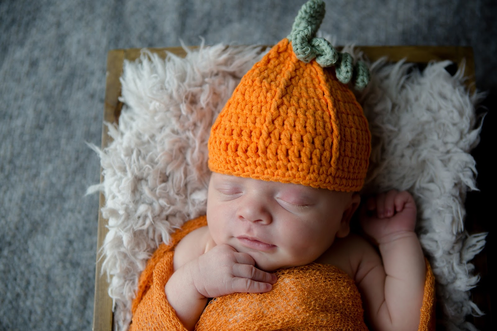 Swaddled pumpkin baby