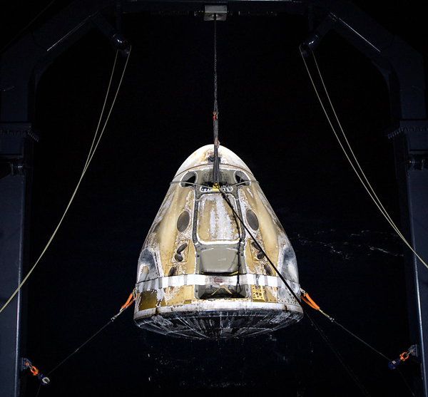 With the Crew-1 astronauts waiting patiently onboard, Resilience is about to be placed onto the deck of SpaceX's GO Navigator recovery ship in the Gulf of Mexico...on May 2, 2011.