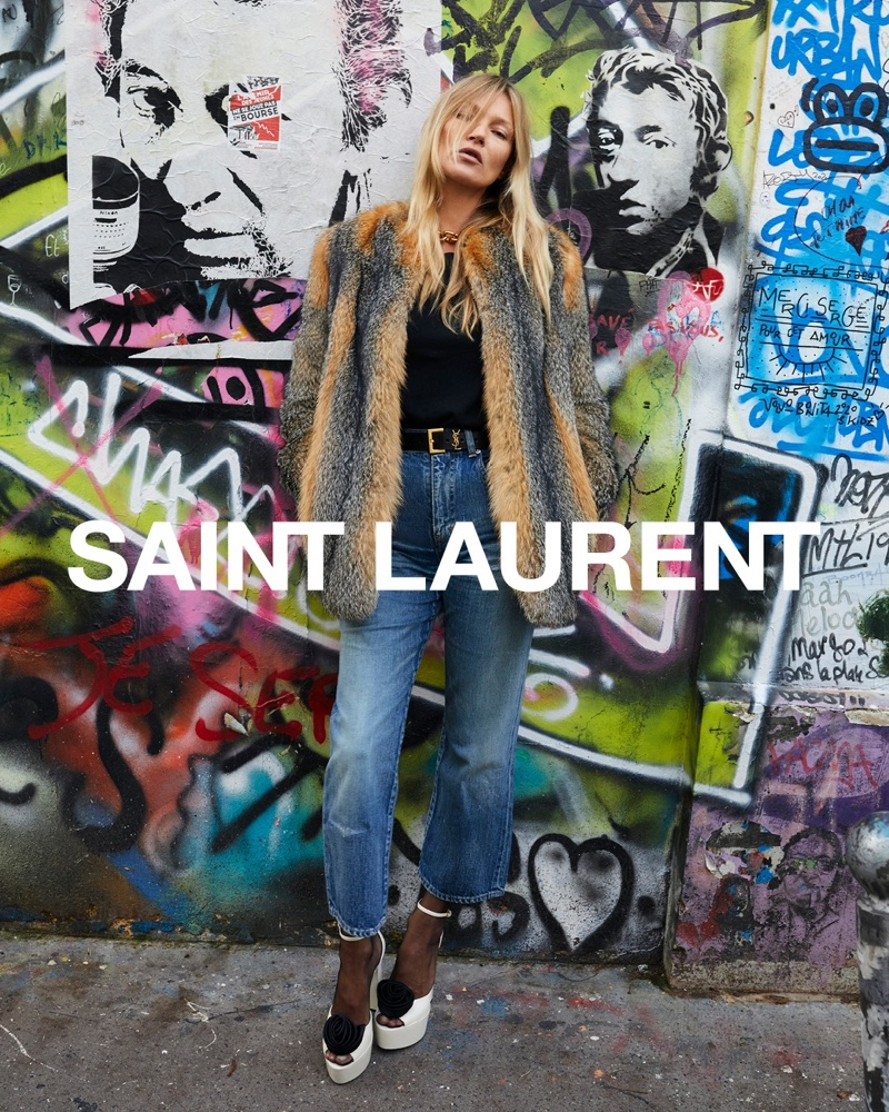 Posing next to graffiti, Kate Moss fronts Saint Laurent spring 2021 campaign.