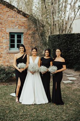 bride and bridesmaids in long black dresses