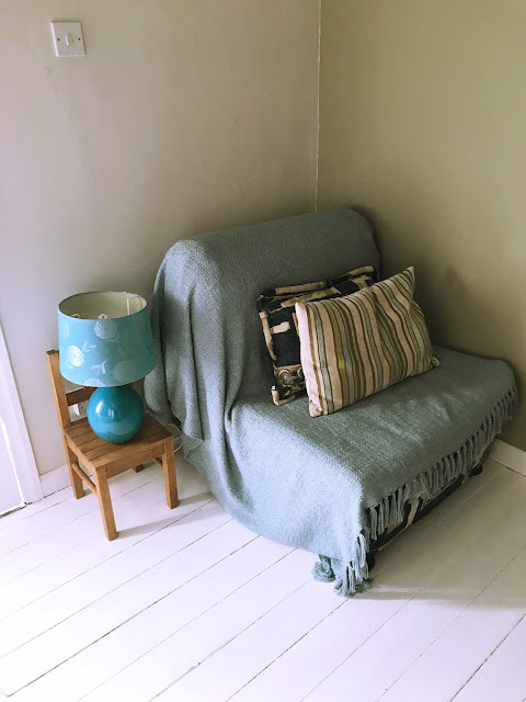 transforming a spare bedroom into a multi functional room - sofa bed