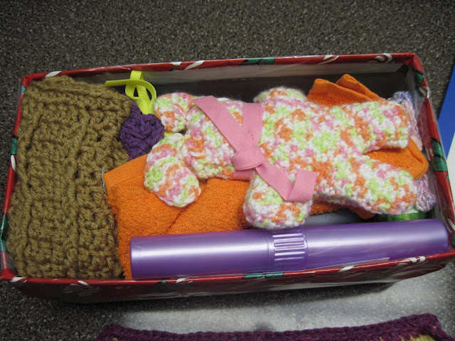 Adding the soft gifts to fit well in an OCC shoebox.