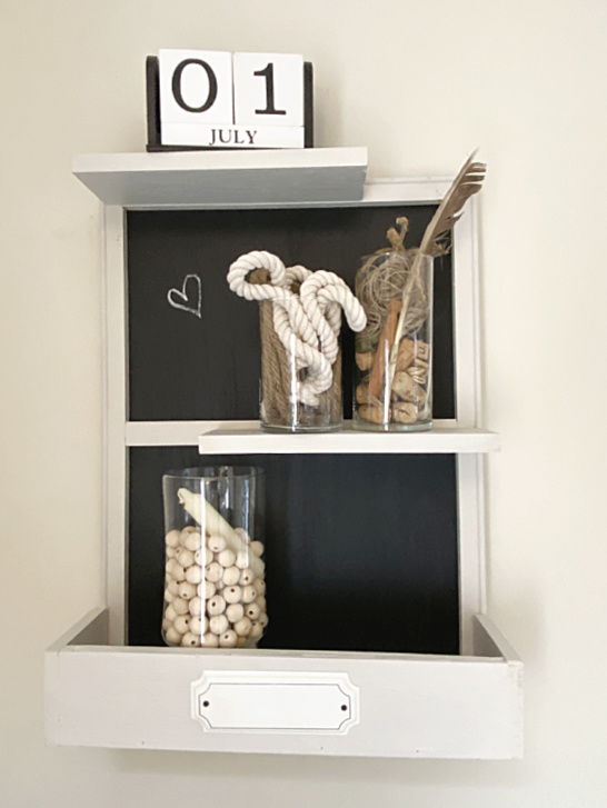shelf filled with jars with neutral craft supplies