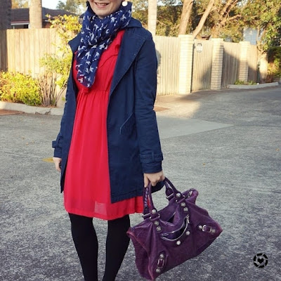 awayfromtheblue instagram navy macintosh coat ruffle dress with purple balenciaga work bag