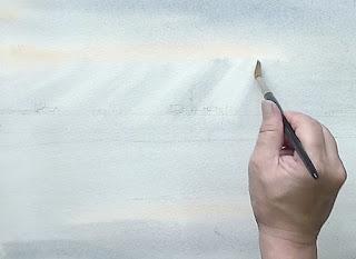 空の絵の具を筆で吸い取ります。