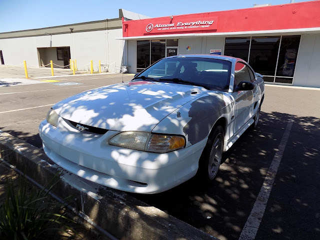 Peeling paint on 1998 Ford Mustang prior to repainting at Almost Everything Auto Body.