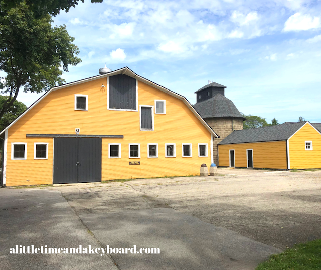 Sizable dairy barn with complex of adjacent buildings at St. James Farm.