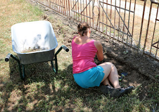 A getting the soil ready for her plants