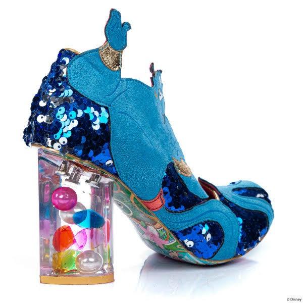 gem filled transparent heel on blue sequins shoe