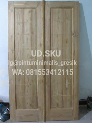 Pintu kupu tarung minimalis kayu jati kamar