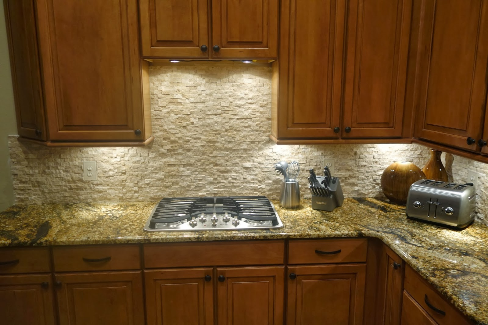 Natural Stone Backsplash on Magma Granite - Owners House