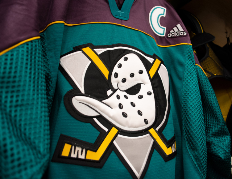 98b7cc78375 The Anaheim Mighty Ducks continued their celebration of 25 great years on  ice with another throwback jersey for warm up November 9th against the  Minnesota ...