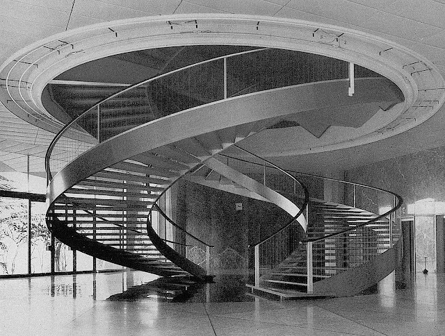 a photograph of a double spiral staircase 1960?