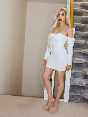 The Femme Luxe White Milkmaid Bodycon Mini Dress in model Elettra
