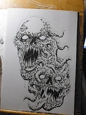 demon heads ink drawing work in progress