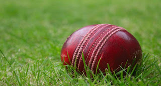 What color is the stitching on a traditional cricket ball?