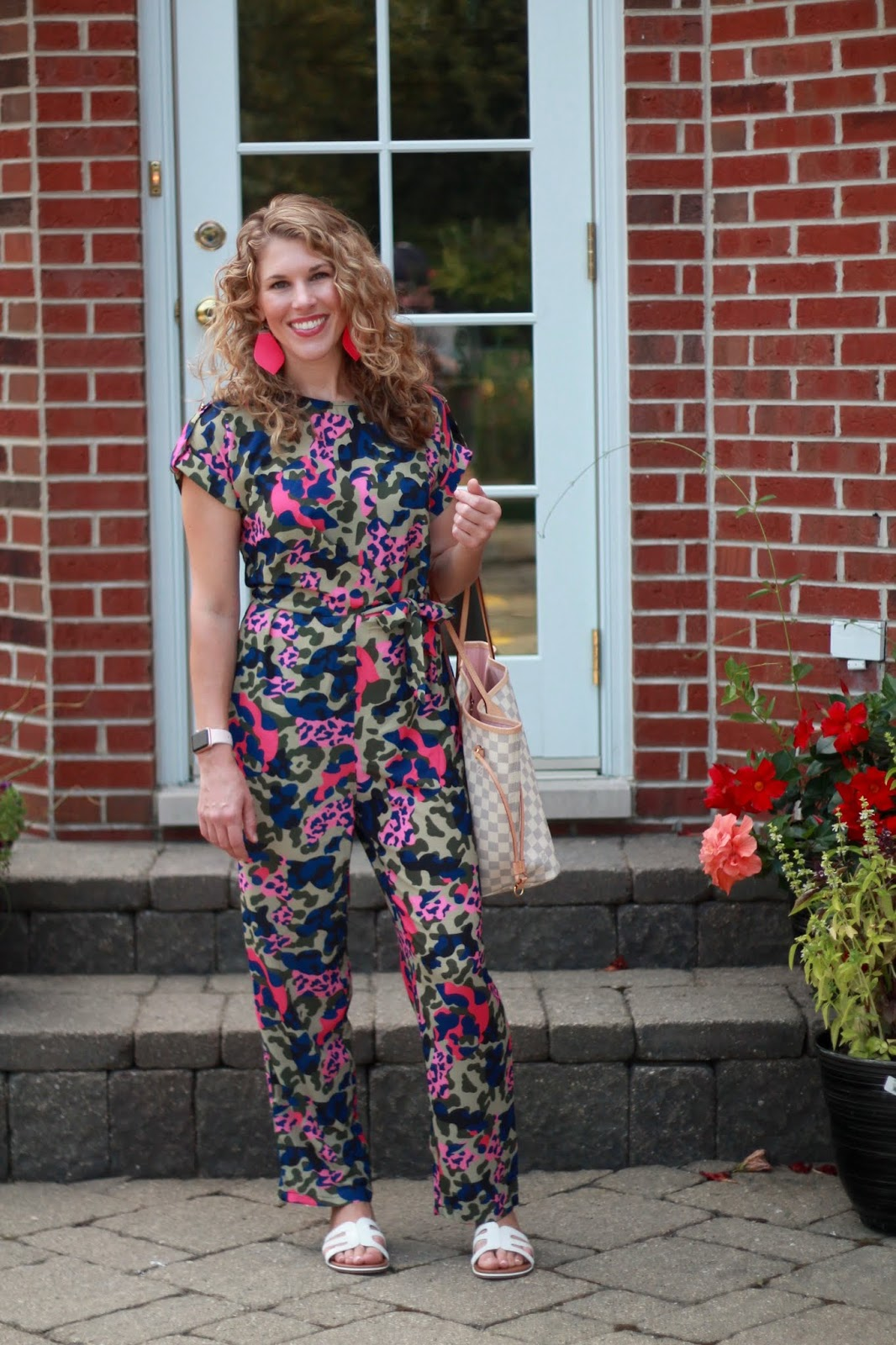 pink camo jumpsuit, white sandals, LV azure neverfull, pink leather earrings