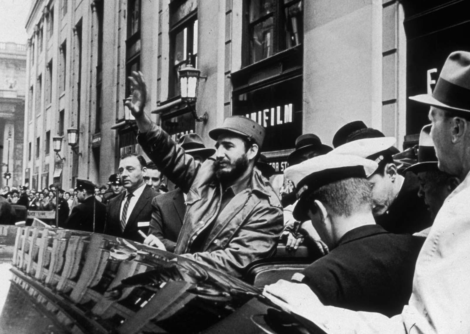 Castro waves to crowds on his way to Pennsylvania Station from the Statler Hilton Hotel in New York City, en route to Boston.
