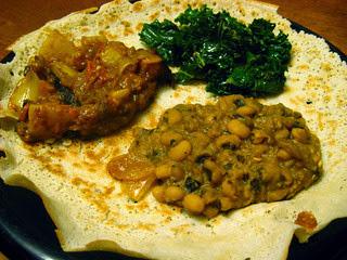 Delicious vegetarian banquet on top of Injera bread
