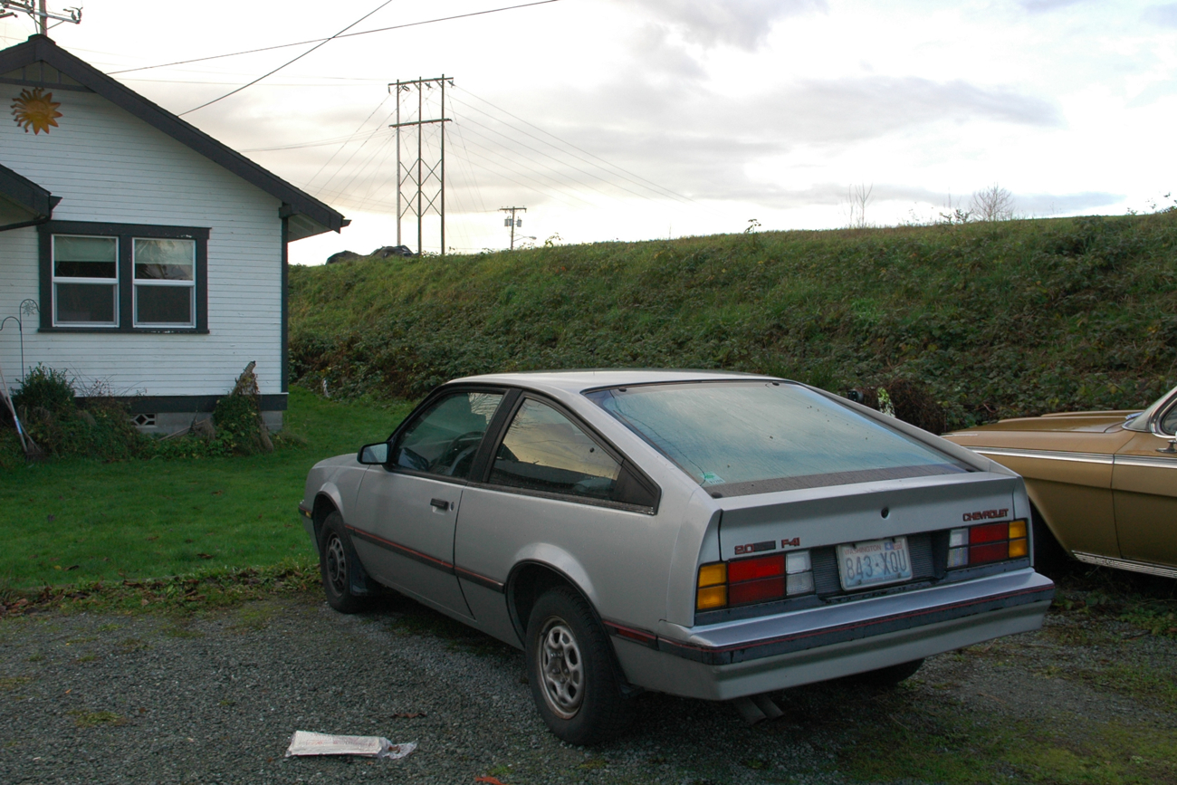 Old Parked Cars 1984 Chevrolet Cavalier F41 And 1961