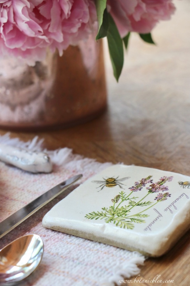 French country early summer table setting includes coasters with lavender designs with French connections