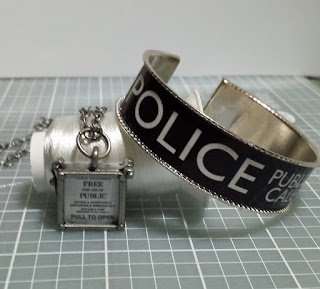 TARDIS door sign pendant and POLICE BOX sign bracelet.