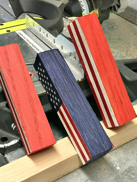 blocks painted with flags decoupaged on them