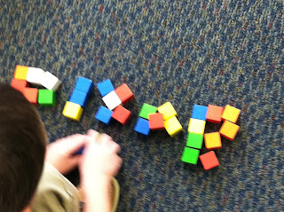 Spelling with cubes (Brick by Brick)