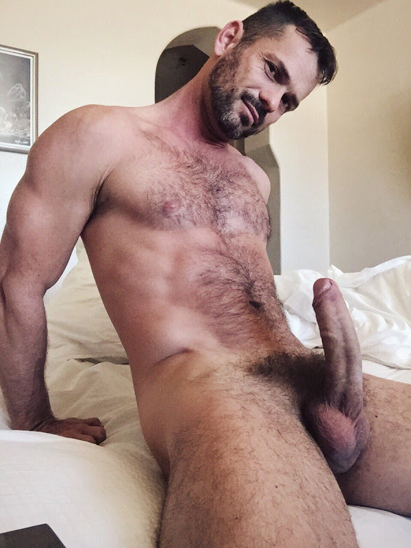 Sexy hairy muscle man with semi hard