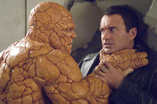 Michael Chiklis as the Thing holding Victor von Doom by the throat in Fantastic Four movieloversreviews.blogspot.com