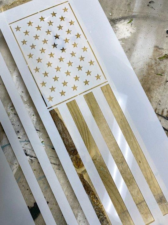 American flag stencil on a picket fence
