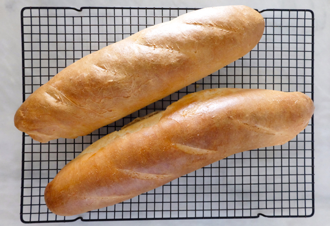 French bread on cooling rack