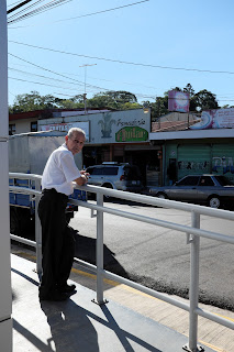 man in front of Banco Nacional in Puriscal