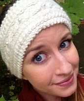 http://www.ravelry.com/patterns/library/winter-cabled-headband-with-pearl-button-accents