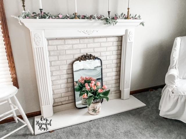 white fireplace mantel farm stool French mirror