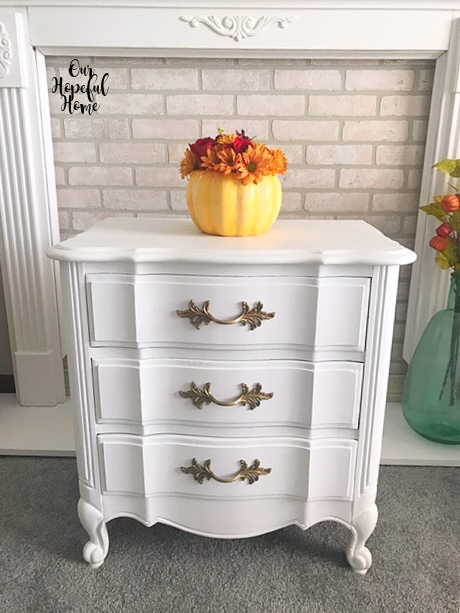 white painted nightstand porcelain pumpkin vase fall flowers mantel faux brick