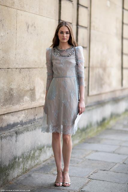 Laura Love in a grey dress