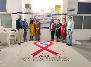 विश्व एड्स दिवस :  रंगोली एवं रेड रिबिन बनाकर जागरूकता का संदेश दिया
