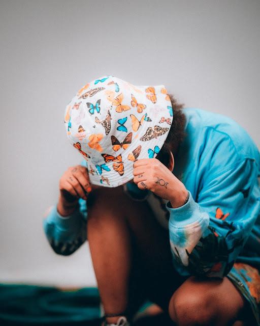 Woman wearing butterfly bucket hat :Photo by Brock Wegner on Unsplash