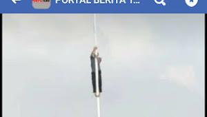 Miris, Warganet Buli Foto Pemuda Panjat Tiang Bendera di Tangan Ilir