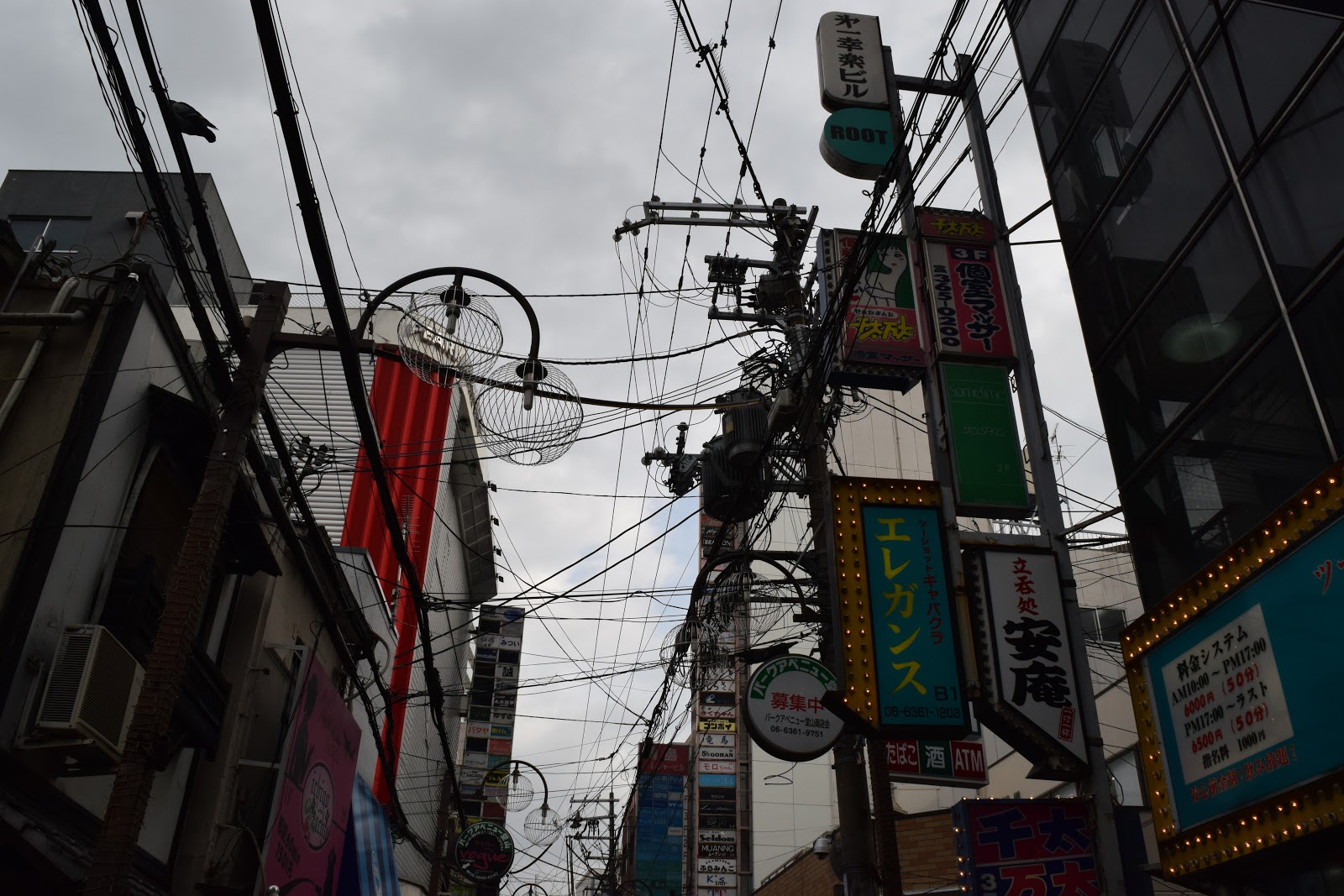 signs, overhead cables and street lights in Umeda, Osaka