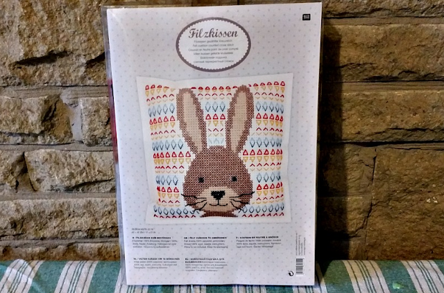 The packaging of the cross stitch kit.
