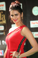 Meenakshi Dixit in Red One Shoulder Red Zipped up gown at IIFA Utsavam Award 36.JPG