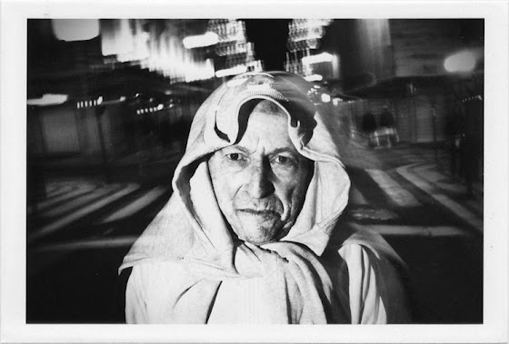 dirty photos - upon - flash street photo of man with scarf in lisboa