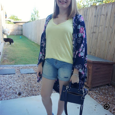 awayfromtheblue Instagram | navy floral kimono with yellow tee and distressed denim shorts mum style