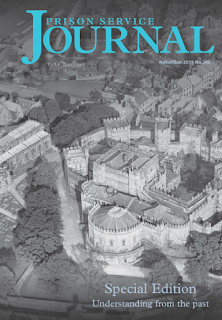 Black and white aerial image of a castle or prison complex, overlaid with text in blue: Prison Service Journal November 2019, No 246, Special Edition: Understanding from the past