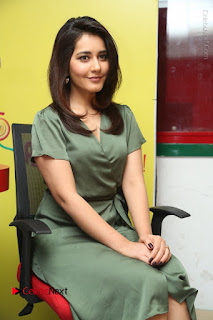 Actress Raashi Khanna Stills in Green Short Dress at Mirchi 95 Suno Aur Mercedes Jeeto Contest  0129.JPG