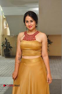 Actress Simrat Juneja Pictures in Golden Long Dress  0065.JPG