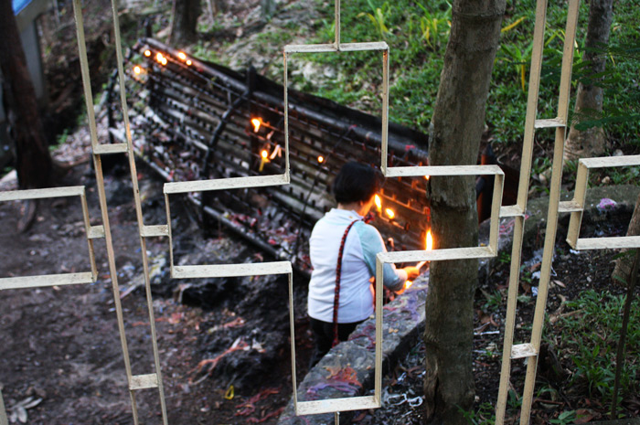 A devotee who braved hundreds of steps to light a candle in Monte Cueva