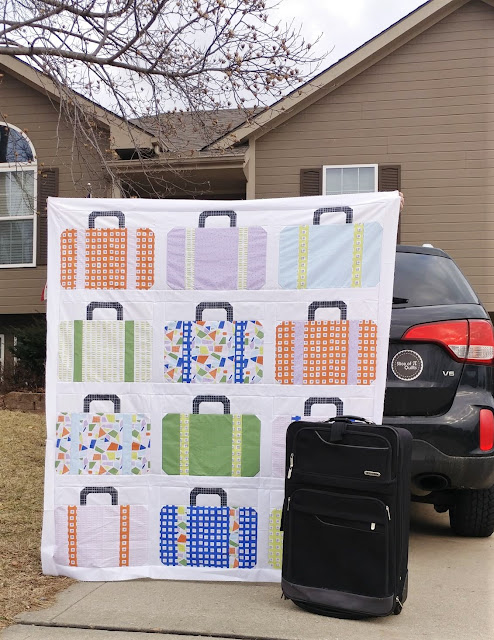 Suitcases quilt using the Road Trip fabric collection